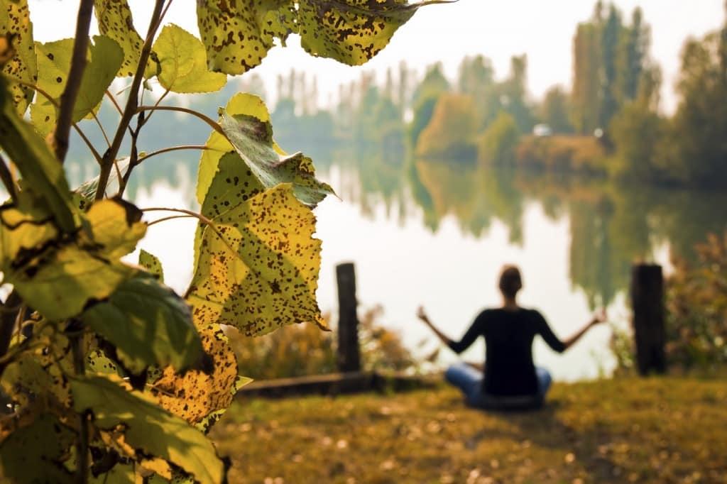 YogaFX Woman doing meditation in Autumn season