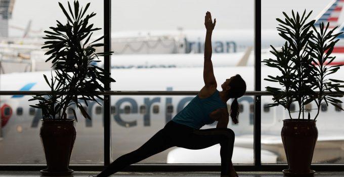 YogaFX Woman doing yoga at airport